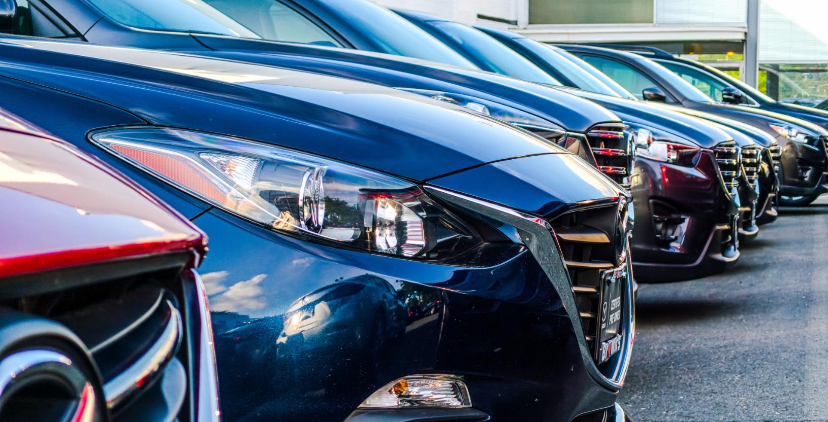 A fleet of parked cars